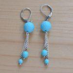 boucles d'oreilles pendantes argentées et turquoise à facettes