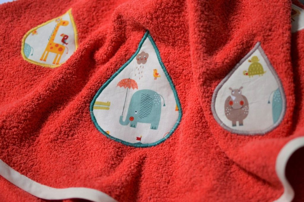 cape de bain bébé orange flashy