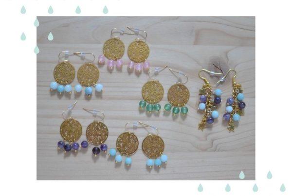 boucles d'oreilles dorées et perles de gemme