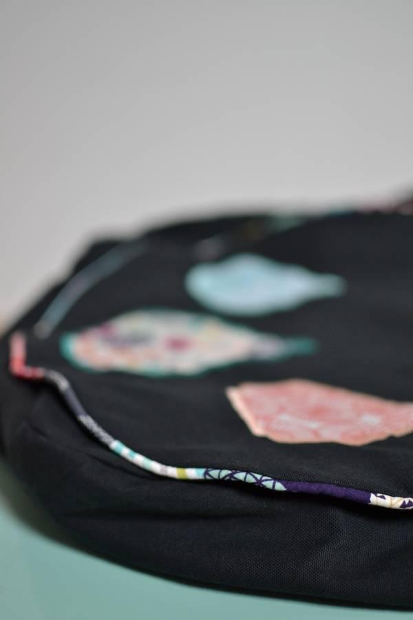 détail passepoil multicolore sac